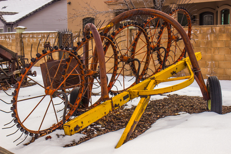 Vintage Farming Equipment In Wintertime Stock Photo