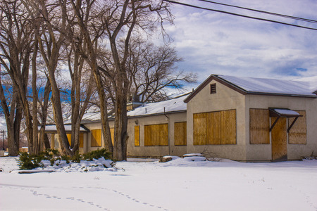 Abandoned Boarded Up Commercial Building In Wintertime