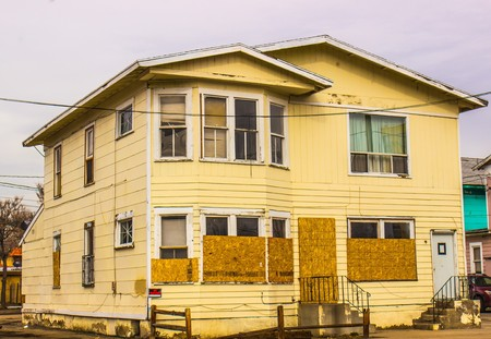 trepassing: Boarded Up Two Story Home Stock Photo
