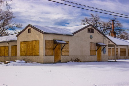 trepassing: Boarded Up Building In Wintertime Stock Photo