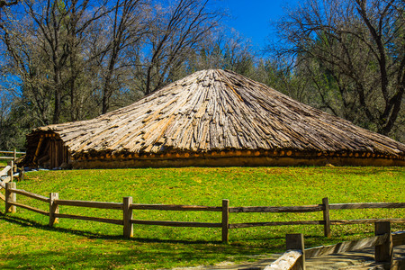 split rail: Conical Shaped American Indian Roundhouse Stock Photo