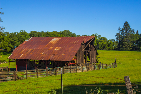 Old Wooden Barn With Rusted Tin Roof