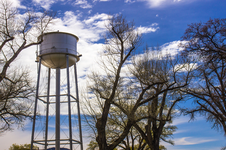 Water Tower Against Blue Sky Stock Photo