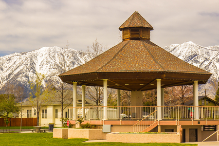 Gazebo In Public Park With Snow Covered Mountains In Background