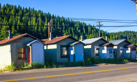telephone poles: Four Abandoned Shanty Cabins In Mountains Stock Photo