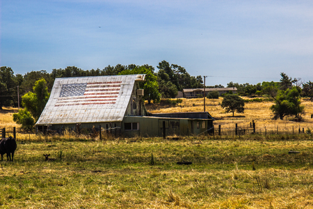 Ranch With Old Sheds & Barn With Faded American Flag
