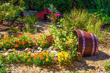 Decorative Wine Barrel In Small Garden Stock Photo