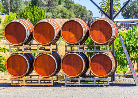 Stack Of Eight Wine Barrels Outside Winery