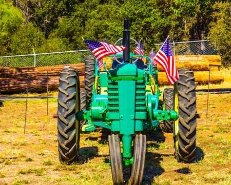 Tractor With American Flags On Display At Small County Fair