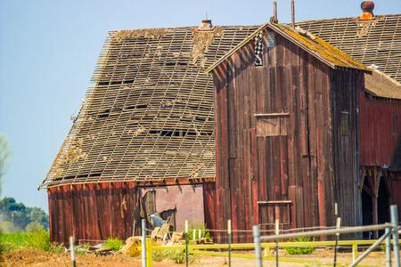 Vintage Wooden Barn In Disrepair Stock Photo