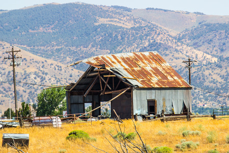 Old Barn With Rusty Tin Roof In Disrepair