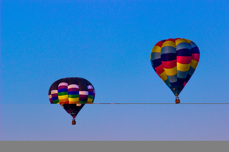 Two Multi Color Hot Air Balloons Stock Photo