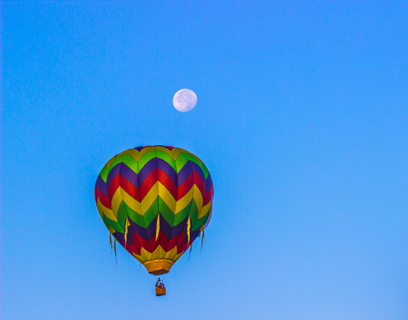Hot Air Balloon Early In Morning With Moon Above