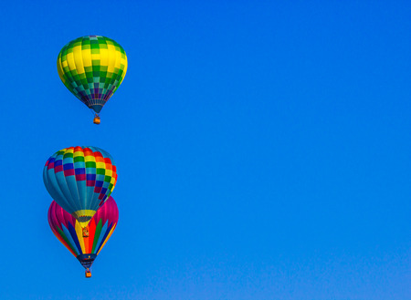Three Multi Color Hot Air Balloons Rising