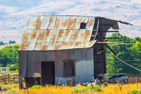 Old Rusty Tin Roof Building In Disrepair