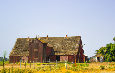 Old Abandoned Wooden Barn With See Through Roof Stock Photo