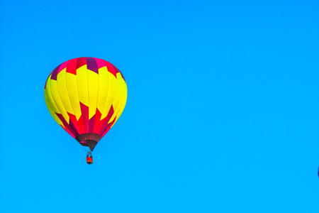 Bright Hot Air Balloon In Early Morning Stock Photo