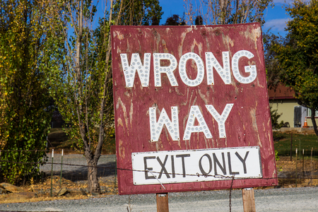 Wrong Way, Exit Only Weathered Sign 写真素材