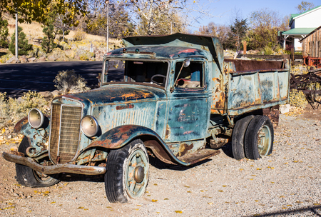 Vintage Rusty Dump Truck With Flat Tires
