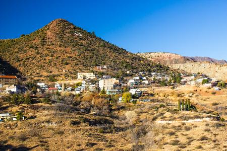 Old Historic Mining Town Built On Side Of Mountain In Arizona High Desert Stock Photo
