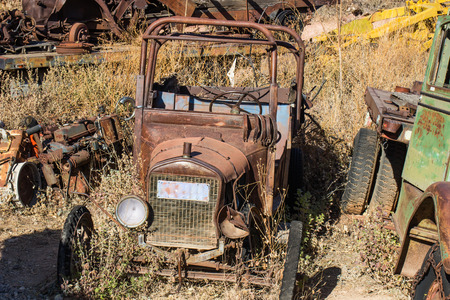 Vintage Rusty Automobile Stripped For Parts In Salvage Yard Stock Photo