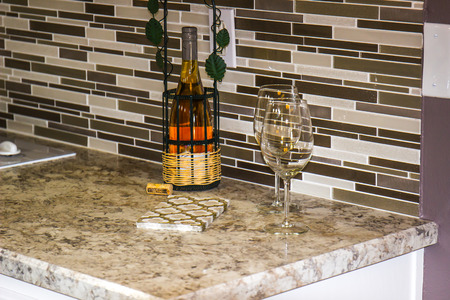 Modern Marble Kitchen Counter With Wine Glasses & Bottle Stock Photo