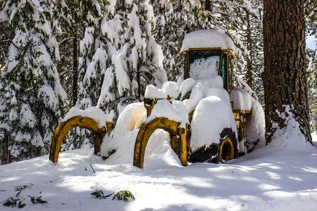 Bulldozer Buried Under Wet Heavy Snow