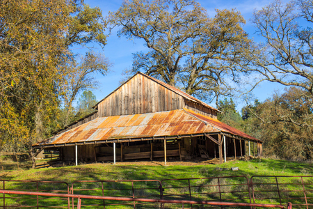 Old Wooden Barn With Rusty Tin Roof