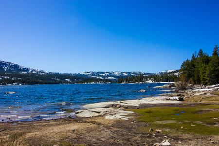Shoreline Of Mountain Lake In Spring