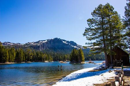 Mountain Lake Shoreline With Springtime Snow Melt