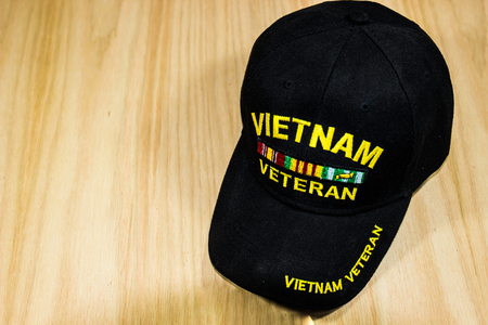 Vietnam Veterans Hat On Light Wood Background