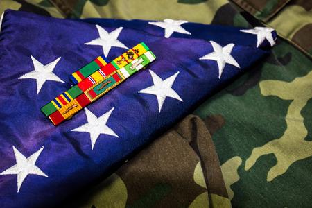 Vietnam Veteran Service Ribbons On Folded American Flag