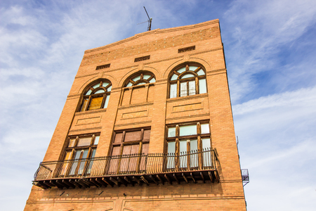 Vintage Brick Building With Boarded Up Windows