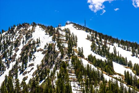 Snow Covered Ski Resort With Ski Lift In Springtime