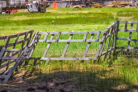 Vintage Leaning Wooden Fence In Field