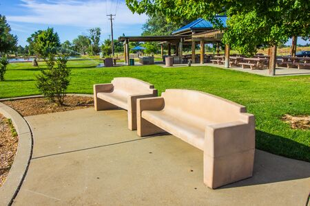 Two Concrete Benches In Local Park In Early Morning Stockfoto