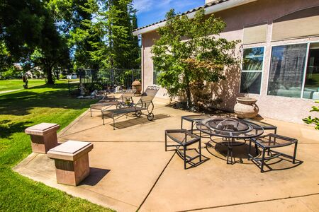 Wrought Iron Lounge Chairs & Fire Pit On Outdoor Patio