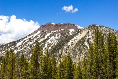 Jagged Peaks Of Mountains With Snow Melting In Spring