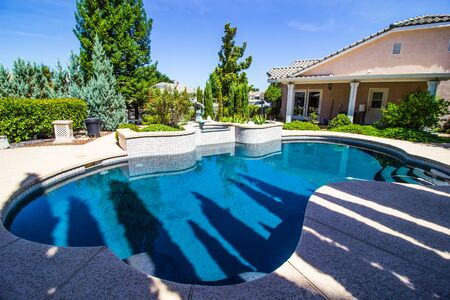 Free Form Swimming Pool In Rear Yard Setting Stockfoto