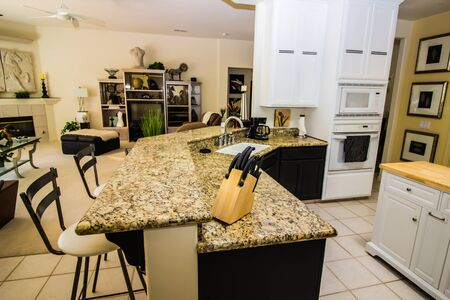 Granite Counter With Bar Stools In Modern Kitchen