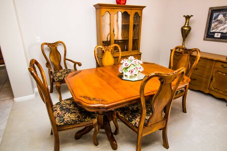 Formal Dining Room With Wooden Table, Chairs, Buffet & Cabinet