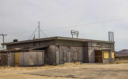 Abandoned Commercial Building With Boarded Up Windows Stock Photo