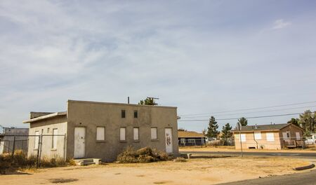 Two Abandoned Homes With Boarded Up Windows