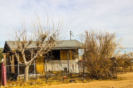 Abandoned One Story Home With Boarded Up Windows