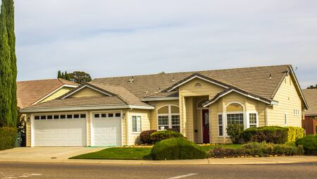 Corner One Story Home With Bay Windows & Three Car Garage