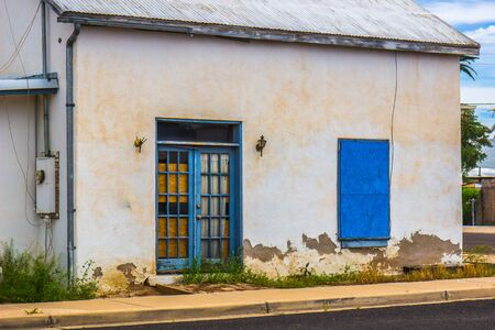 Old Abandoned Building With Boarded Up Doors & Window Stok Fotoğraf