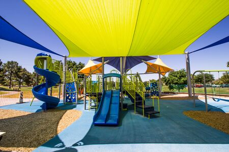 Kid's Playground Equipment Covered By Colorful Canopies Standard-Bild