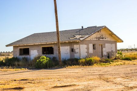 Abandoned Home In Disrepair With Broken Windows Stock Photo