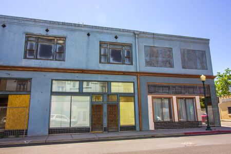 Row Of Abandoned Commercial Two Story Store Front Buildings In Disrepair