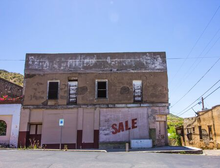 Abandoned Boarded Up Two Story Commercial Store Front Building Stock Photo